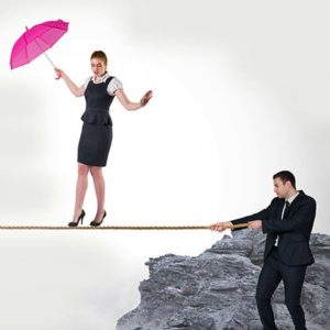 Woman accountant holding a pink umbrella walking on a rope a business accountant is holding